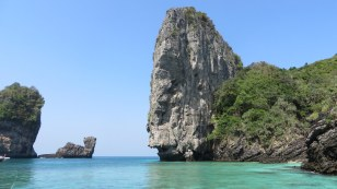 Typical limestone formation at head of a pretty bay with pretty beach