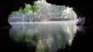 We enter a tunnel, and emerge in a lake surrounded by cliffs. Remember, this is on an island.