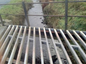 Just a cattle grid over a river.
