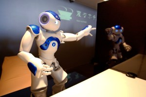 "A front desk robot performs at robot hotel ""Henn na Hotel"" in Sasebo, western Japan, Wednesday, July 15, 2015. (AP Photo/Shizuo Kambayashi)"