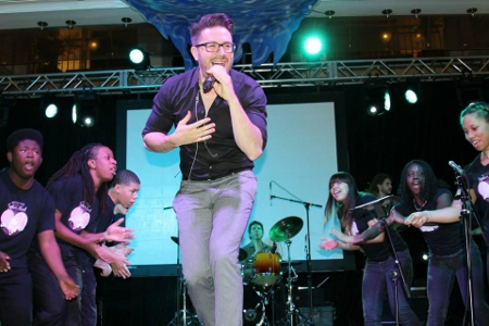 Danny Gokey performing with the Sophia's Heart Kids Choir