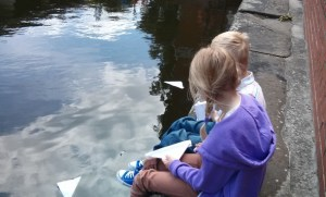 The kids sailing paper boats