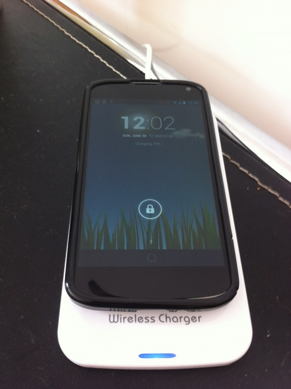PowerQI Wireless Phone Charger in use.