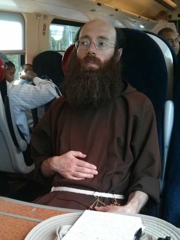Train journey to Liverpool - Monk on train - Taken from an article by DannyUK.com