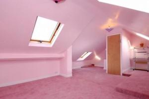 A very pink attic bedroom.