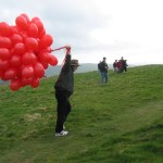 Paul struggles to bring the balloons to the very top