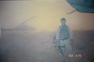 A picture of me taken shortly after the dust storm forced us to land at Camden Yards FARP, 25 March 2003.  pg. 184