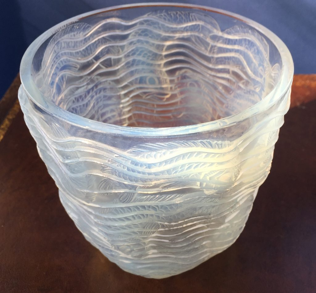 A Lalique vase done by the artist Dauphins