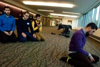 Ahmed leads three friends in evening prayers before the Fast-a-thon banquet on Tuesday, Feb. 25, 2014 in the UW's Husky Union Building.