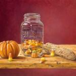 """""""Canning Candy Corn"""" 11″ x 14″, oil on board by Daphne Wynne Nixon"""