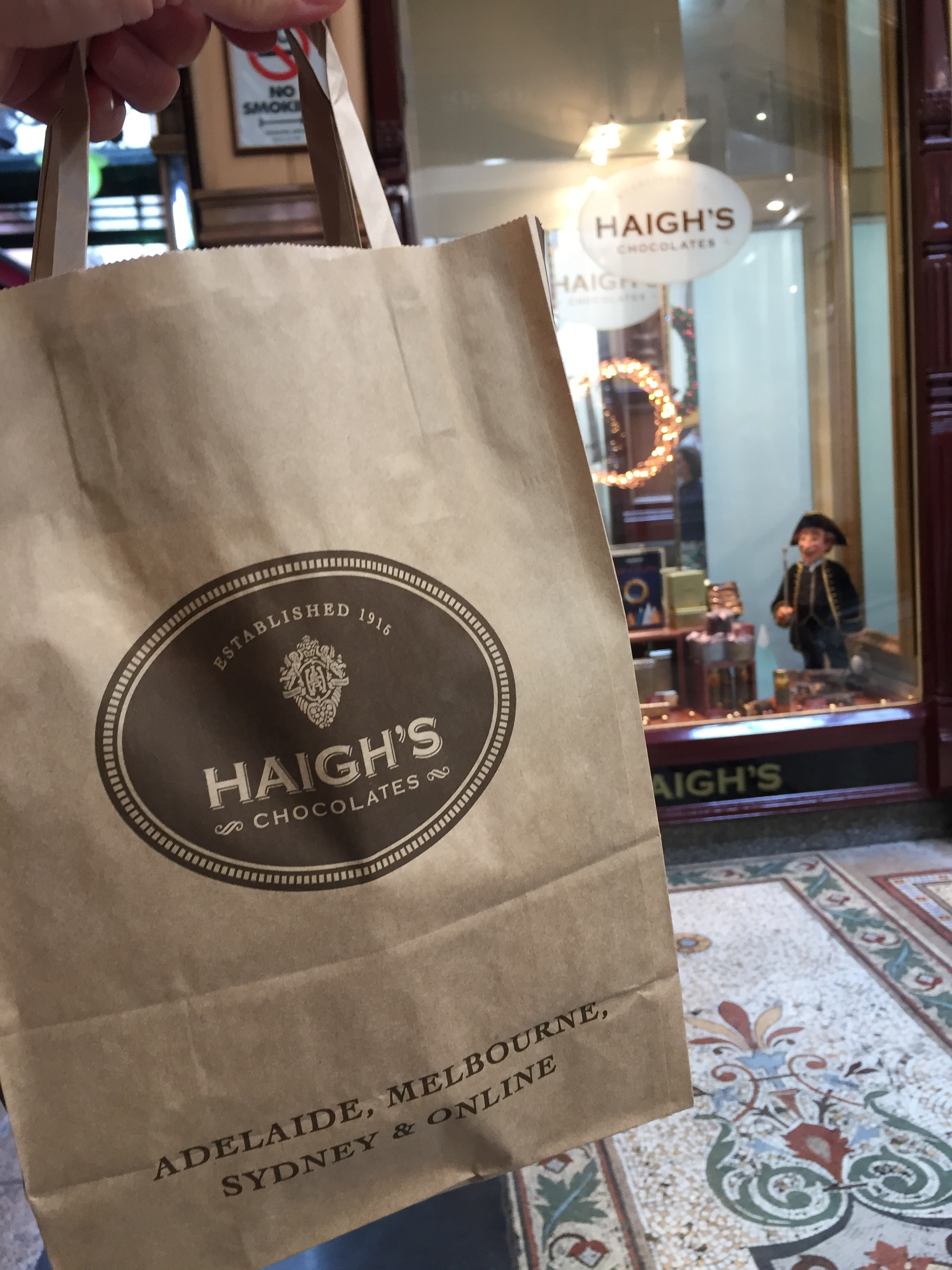 Brown kraft store bag outside the Haigh's Chocolates store in Melbourne