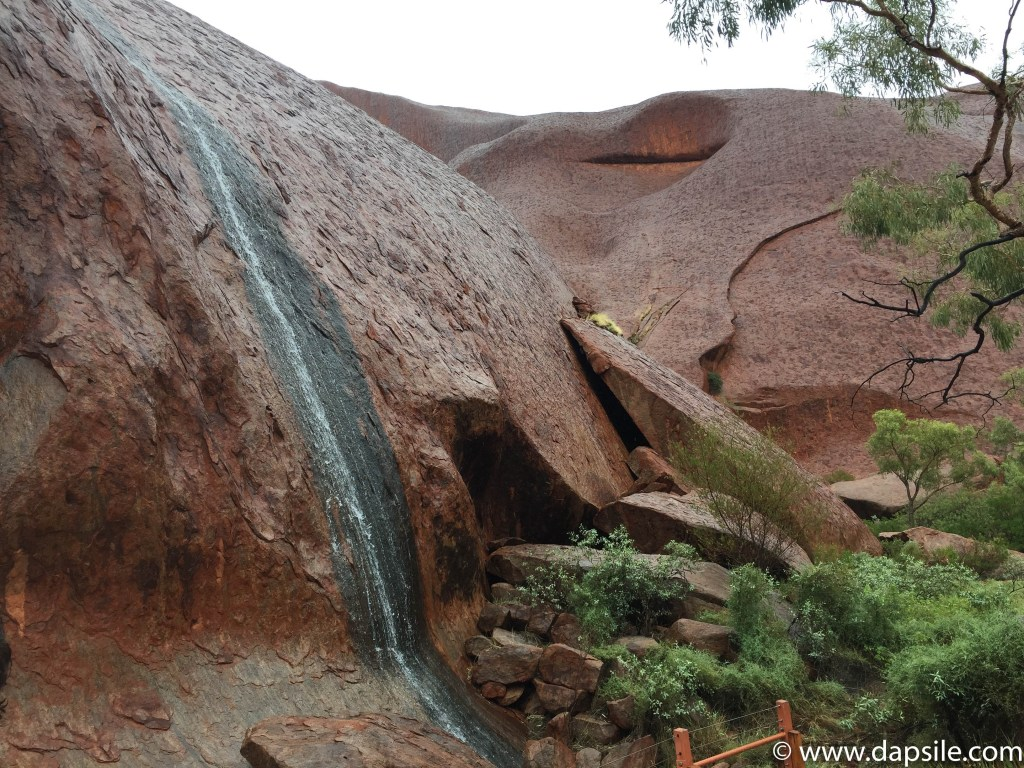 Rain and Uluru on tour from Alice Springs to Uluru