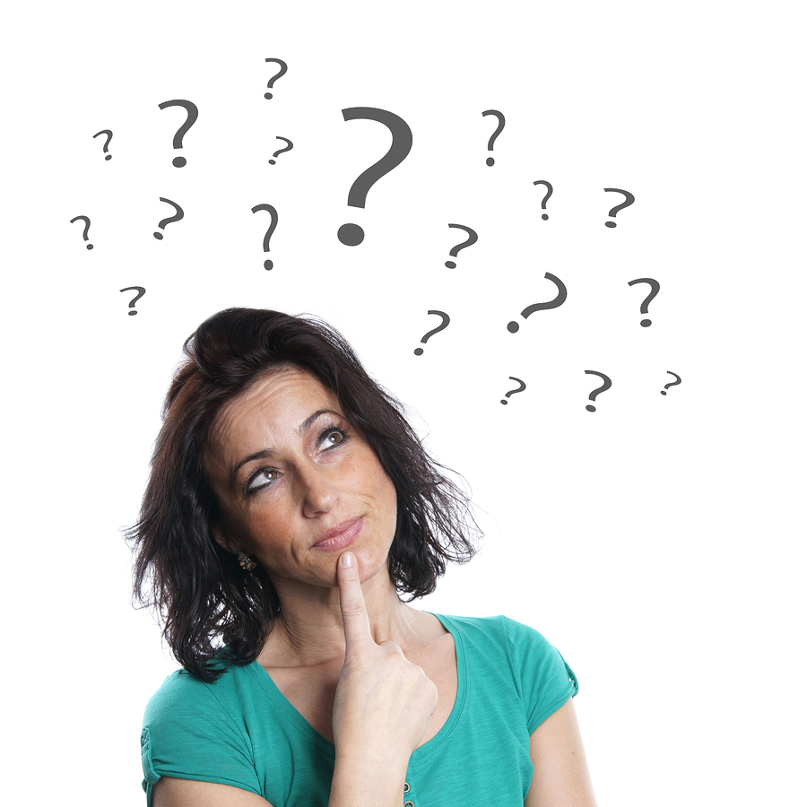 middle aged woman thinking with question marks Symptoms of Menopause