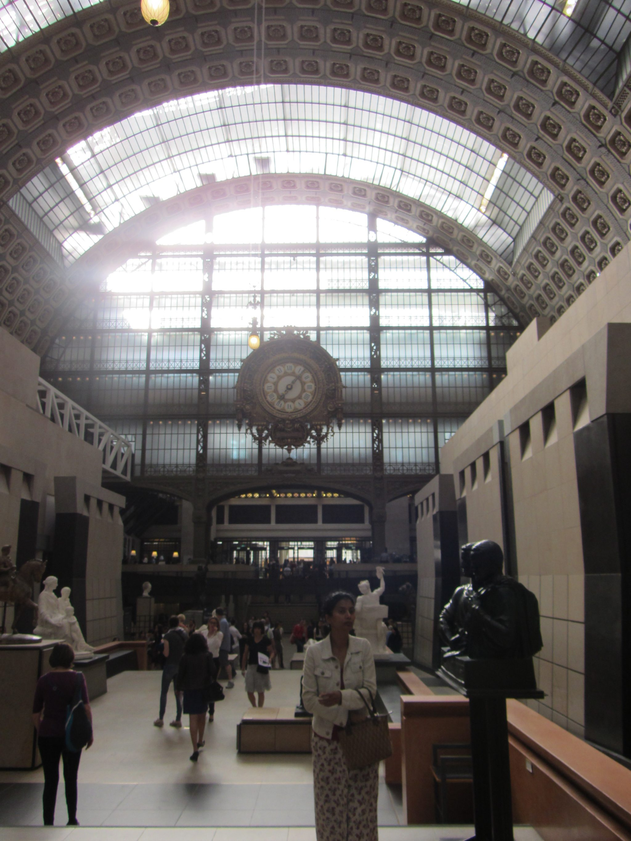 Looking at the Wall of Windows and the Big Clock in the Main Hall of the Musee d'Orsay in Paris