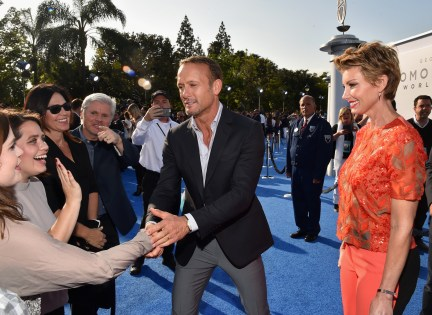 """ANAHEIM, CA - MAY 09: Singers Tim McGraw (L) and Faith Hill attend the world premiere of Disney's """"Tomorrowland"""" at Disneyland, Anaheim on May 9, 2015 in Anaheim, California. (Photo by Alberto E. Rodriguez/Getty Images for Disney) *** Local Caption *** Faith Hill;Tim McGraw"""