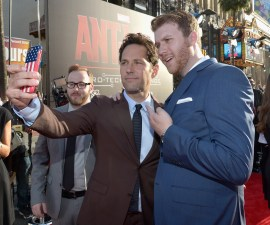 """LOS ANGELES, CA - JUNE 29: Actor Paul Rudd (C) takes a selfie at the OMAZE booth at the world premiere of Marvel's """"Ant-Man"""" at The Dolby Theatre on June 29, 2015 in Los Angeles, California. (Photo by Charley Gallay/Getty Images) *** Local Caption *** Paul Rudd"""