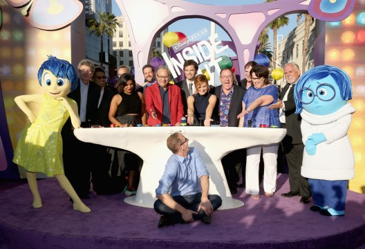 HOLLYWOOD, CA - JUNE 08: (L-R) Joy, Chairman, The Walt Disney Studios, Alan Horn, co-director Ronnie Del Carmen, President at Pixar Animation Studios Jim Morris, Actress Mindy Kaling, Composer Michael Giacchino, actors Lewis Black, Bill Hader, Amy Poehler, executive producer John Lasseter, actors Richard Kind, Phyllis Smith, John Ratzenberger, director/writer/screenwriter Pete Docter (bottom) and Sadness attend the Los Angeles Premiere and Party for Disney•Pixar's INSIDE OUT at El Capitan Theatre on June 8, 2015 in Hollywood, California. (Photo by Jesse Grant/Getty Images for Disney) *** Local Caption *** Alan Horn; Ronnie Del Carmen; Jim Morris; Mindy Kaling; Michael Giacchino; Lewis Black; Bill Hader; Amy Poehler; John Lasseter; Richard Kind; Phyllis Smith; John Ratzenberger; Pete Docter; Joy; Sadness