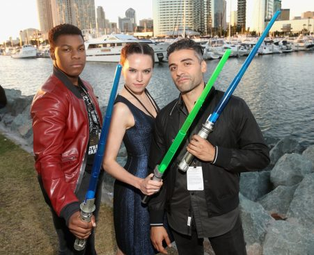 SAN DIEGO, CA - JULY 10: (L-R) Actors John Boyega, Daisy Ridley, Oscar Isaac and more than 6000 fans enjoyed a surprise `Star Wars` Fan Concert performed by the San Diego Symphony, featuring the classic `Star Wars` music of composer John Williams, at the Embarcadero Marina Park South on July 10, 2015 in San Diego, California. (Photo by Jesse Grant/Getty Images for Disney) *** Local Caption *** Oscar Isaac; John Boyega; Daisy Ridley