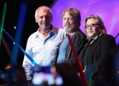 "SAN DIEGO, CA - JULY 10: (L-R) Actors Harrison Ford, Mark Hamill, Carrie Fisher and more than 6000 fans enjoyed a surprise `Star Wars` Fan Concert performed by the San Diego Symphony, featuring the classic ""Star Wars"" music of composer John Williams, at the Embarcadero Marina Park South on July 10, 2015 in San Diego, California. (Photo by Jesse Grant/Getty Images for Disney) *** Local Caption *** Harrison Ford; Mark Hamill; Carrie Fisher"