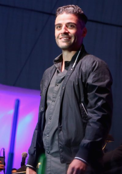 SAN DIEGO, CA - JULY 10: Actors Oscar Isaac and more than 6000 fans enjoyed a surprise `Star Wars` Fan Concert performed by the San Diego Symphony, featuring the classic `Star Wars` music of composer John Williams, at the Embarcadero Marina Park South on July 10, 2015 in San Diego, California. (Photo by Jesse Grant/Getty Images for Disney) *** Local Caption *** Oscar Isaac