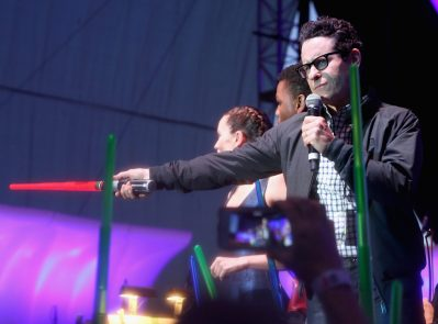 SAN DIEGO, CA - JULY 10: (L-R) Actors Daisy Ridley, John Boyega, director J.J. Abrams and more than 6000 fans enjoyed a surprise `Star Wars` Fan Concert performed by the San Diego Symphony, featuring the classic `Star Wars` music of composer John Williams, at the Embarcadero Marina Park South on July 10, 2015 in San Diego, California. (Photo by Jesse Grant/Getty Images for Disney) *** Local Caption *** Daisy Ridley; John Boyega; J.J. Abrams