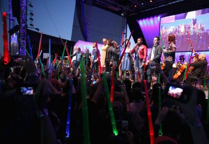 SAN DIEGO, CA - JULY 10: (L-R) Actors Harrison Ford, Mark Hamill, Carrie Fisher, Domhnall Gleeson, Gwendoline Christie, Adam Driver, Oscar Isaac, Daisy Ridley, John Boyega, director J.J. Abrams, producer Kathleen Kennedy and more than 6000 fans enjoyed a surprise `Star Wars` Fan Concert performed by the San Diego Symphony, featuring the classic `Star Wars` music of composer John Williams, at the Embarcadero Marina Park South on July 10, 2015 in San Diego, California. (Photo by Jesse Grant/Getty Images for Disney) *** Local Caption *** Harrison Ford; Mark Hamill; Carrie Fisher; Domhnall Gleeson; Gwendoline Christie; Adam Driver; Oscar Isaac; Daisy Ridley; John Boyega; J.J. Abrams; Kathleen Kennedy