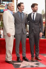 HOLLYWOOD, CA - JULY 01: Actor Paul Rudd (C) poses with actors Michael Douglas (L) and Adam Scott as he is honored with a star on the Hollywood Walk Of Fame on July 1, 2015 in Hollywood, California. (Photo by Jesse Grant/Getty Images for Disney) *** Local Caption *** Michael Douglas;Paul Rudd;Adam Scott