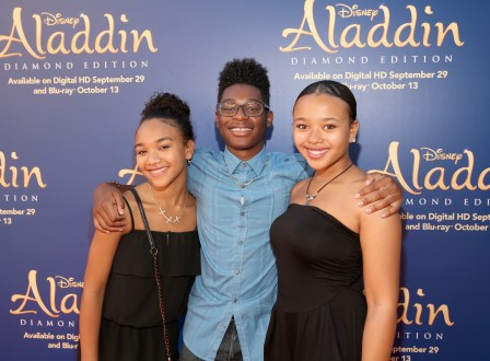 """BURBANK, CA - SEPTEMBER 27: Actor Kamil McFadden (C) and friends attend a special LA screening celebrating Diamond Edition release of """"ALADDIN"""" at The Walt Disney Studios on September 27, 2015 in Burbank, California. (Photo by Jesse Grant/Getty Images for Disney) *** Local Caption *** Kamil McFadden"""
