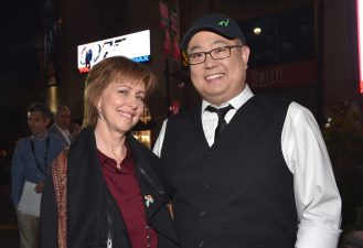 """HOLLYWOOD, CA - NOVEMBER 17: """"Sanjay's Super Team"""" producer Nicole Paradis Grindle (L) and """"The Good Dinosaur"""" director Peter Sohn attend the World Premiere Of Disney-Pixar's THE GOOD DINOSAUR at the El Capitan Theatre on November 17, 2015 in Hollywood, California. (Photo by Alberto E. Rodriguez/Getty Images for Disney) *** Local Caption *** Peter Sohn; Nicole Paradis Grindle"""