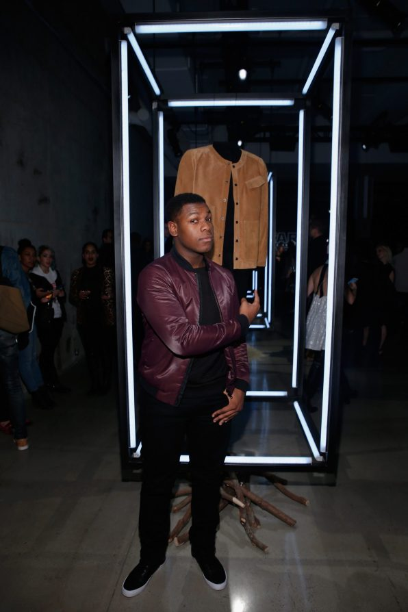 NEW YORK, NY - DECEMBER 02: Actor John Boyega poses with Timo Weilands Star Wars-inspired look for the Force 4 Fashion Event on Dec. 2 at the Skylight Modern in NYC. Top designers showcased bespoke looks inspired by characters from Star Wars: The Force Awakens that will be auctioned off for Bloomingdales holiday charity. (Photo by Brian Ach/Getty Images for Disney Consumer Products)