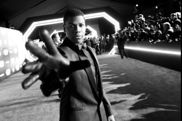 HOLLYWOOD, CA - DECEMBER 14: (EDITORS NOTE: Image has been shot in black and white. Color version not available.) Actor John Boyega attends the World Premiere of ?Star Wars: The Force Awakens? at the Dolby, El Capitan, and TCL Theatres on December 14, 2015 in Hollywood, California. (Photo by Charley Gallay/Getty Images for Disney) *** Local Caption *** John Boyega