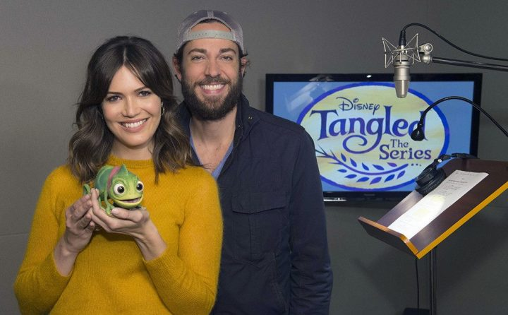 """TANGLED - Mandy Moore and Zachary Levi were greeted by a special visitor, Pascal (Rapunzel's pet chameleon) in the form of an Audio-Animatronics character created by Walt Disney Imagineering, at a voice recording session for Disney's upcoming """"Tangled: The Series"""" in Burbank, California on October 4, 2016.  The animated TV series is slated to debut on Disney Channel in 2017. (Disney Channel/Matt Petit) MANDY MOORE, ZACHARY LEVI"""