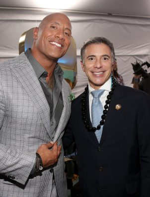 """HOLLYWOOD, CA - NOVEMBER 14: Actor Dwayne Johnson (L) and Walt Disney Studios President of Marketing Ricky Strauss attend The World Premiere of Disney's """"MOANA"""" at the El Capitan Theatre on Monday, November 14, 2016 in Hollywood, CA. (Photo by Jesse Grant/Getty Images for Disney) *** Local Caption *** Dwayne Johnson; Ricky Strauss"""