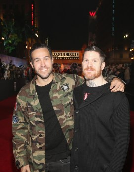 """HOLLYWOOD, CA - DECEMBER 10: Musicians Pete Wentz (L) and Andy Hurley of Fall Out Boy attend The World Premiere of Lucasfilm's highly anticipated, first-ever, standalone Star Wars adventure, """"Rogue One: A Star Wars Story"""" at the Pantages Theatre on December 10, 2016 in Hollywood, California. (Photo by Jesse Grant/Getty Images for Disney) *** Local Caption *** Pete Wentz; Andy Hurley"""