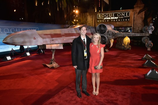 """HOLLYWOOD, CA - DECEMBER 10: Actress Emily Osment (R) and guest attend The World Premiere of Lucasfilm's highly anticipated, first-ever, standalone Star Wars adventure, """"Rogue One: A Star Wars Story"""" at the Pantages Theatre on December 10, 2016 in Hollywood, California. (Photo by Marc Flores/Getty Images for Disney) *** Local Caption *** Emily Osment"""