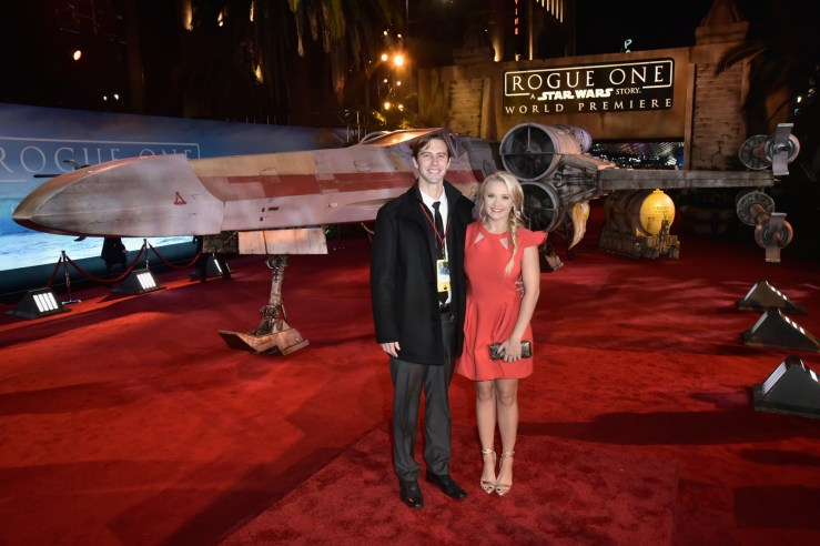 "HOLLYWOOD, CA - DECEMBER 10: Actress Emily Osment (R) and guest attend The World Premiere of Lucasfilm's highly anticipated, first-ever, standalone Star Wars adventure, ""Rogue One: A Star Wars Story"" at the Pantages Theatre on December 10, 2016 in Hollywood, California. (Photo by Marc Flores/Getty Images for Disney) *** Local Caption *** Emily Osment"