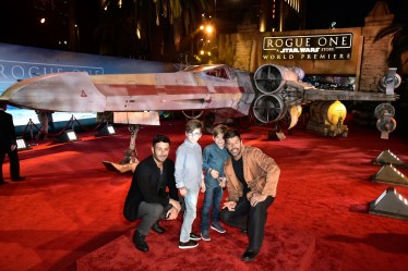 "HOLLYWOOD, CA - DECEMBER 10: Singer Ricky Martin (R) with children and artist Jwan Yosef (L) attend The World Premiere of Lucasfilm's highly anticipated, first-ever, standalone Star Wars adventure, ""Rogue One: A Star Wars Story"" at the Pantages Theatre on December 10, 2016 in Hollywood, California. (Photo by Marc Flores/Getty Images for Disney) *** Local Caption *** Ricky Martin; Matteo Martin; Valentino Martin; Jwan Yosef"