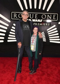 """HOLLYWOOD, CA - DECEMBER 10: Actor Peter Mayhew (L) and Angie Mayhew attend The World Premiere of Lucasfilm's highly anticipated, first-ever, standalone Star Wars adventure, """"Rogue One: A Star Wars Story"""" at the Pantages Theatre on December 10, 2016 in Hollywood, California. (Photo by Earl Gibson III/Getty Images for Disney) *** Local Caption *** Peter Mayhew; Angie Mayhew"""