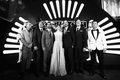 "HOLLYWOOD, CA - DECEMBER 10: (EDITORS NOTE: Image has been shot in black and white. Color version not available.) (L-R) Actors Ben Mendelsohn, Mads Mikkelsen, Riz Ahmed, Felicity Jones, Diego Luna, Alan Tudyk, and Donnie Yen attend The World Premiere of Lucasfilm's highly anticipated, first-ever, standalone Star Wars adventure, ""Rogue One: A Star Wars Story"" at the Pantages Theatre on December 10, 2016 in Hollywood, California. (Photo by Charley Gallay/Getty Images for Disney) *** Local Caption *** Ben Mendelsohn; Riz Ahmed; Felicity Jones; Diego Luna; Donnie Yen; Mads Mikkelsen; Alan Tudyk"