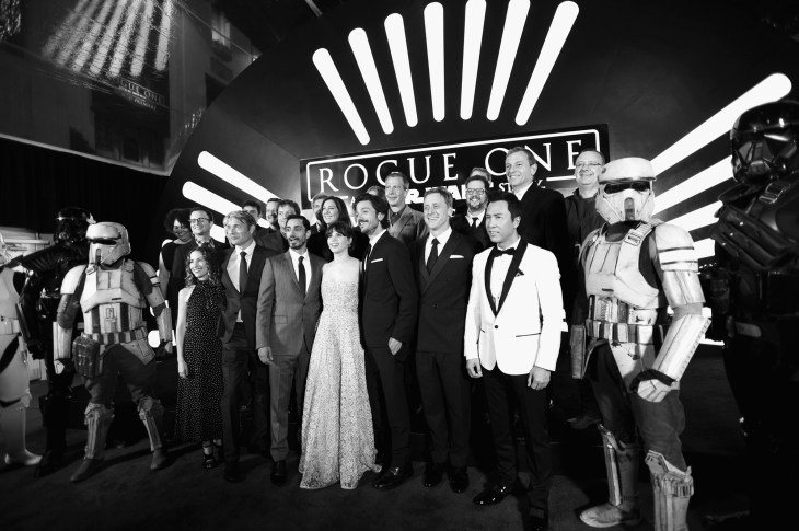 "HOLLYWOOD, CA - DECEMBER 10: (EDITORS NOTE: Image has been shot in black and white. Color version not available.) (L-R front row) Producer Allison Shearmur, actors Mads Mikkelsen, Riz Ahmed, Felicity Jones, Diego Luna, Alan Tudyk and Donnie Yen (back row) Director Gareth Edwards, Producer Kathleen Kennedy, actor Ben Mendelsohn, composer Michael Giacchino and The Walt Disney Company Chairman and CEO Bob Iger attend The World Premiere of Lucasfilm's highly anticipated, first-ever, standalone Star Wars adventure, ""Rogue One: A Star Wars Story"" at the Pantages Theatre on December 10, 2016 in Hollywood, California. (Photo by Charley Gallay/Getty Images for Disney) *** Local Caption *** Allison Shearmur; Mads Mikkelsen; Riz Ahmed; Felicity Jones; Diego Luna; Alan Tudyk; Donnie Yen; Gareth Edwards; Kathleen Kennedy; Ben Mendelsohn; Michael Giacchino; Bob Iger"