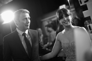 "HOLLYWOOD, CA - DECEMBER 10: (EDITORS NOTE: Image has been shot in black and white. Color version not available.) Actors Mads Mikkelsen (L) and Felicity Jones attend The World Premiere of Lucasfilm's highly anticipated, first-ever, standalone Star Wars adventure, ""Rogue One: A Star Wars Story"" at the Pantages Theatre on December 10, 2016 in Hollywood, California. (Photo by Charley Gallay/Getty Images for Disney) *** Local Caption *** Felicity Jones; Mads Mikkelsen"