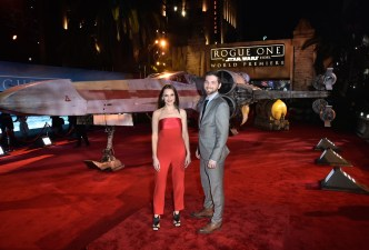 """HOLLYWOOD, CA - DECEMBER 10: Actors Rachael Leigh Cook (L) and Daniel Gillies attend The World Premiere of Lucasfilm's highly anticipated, first-ever, standalone Star Wars adventure, """"Rogue One: A Star Wars Story"""" at the Pantages Theatre on December 10, 2016 in Hollywood, California. (Photo by Marc Flores/Getty Images for Disney) *** Local Caption *** Rachael Leigh Cook; Daniel Gillies"""