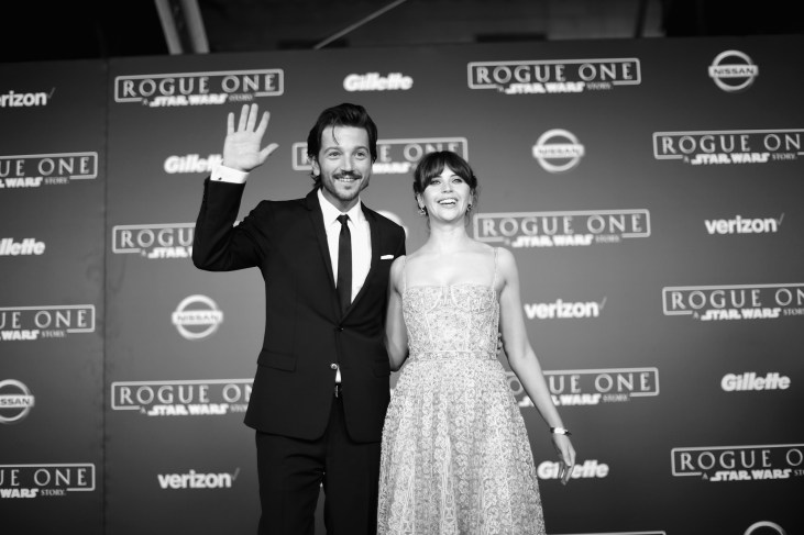 "HOLLYWOOD, CA - DECEMBER 10: (EDITORS NOTE: Image has been shot in black and white. Color version not available.) Actors Diego Luna (L) and Felicity Jones attend The World Premiere of Lucasfilm's highly anticipated, first-ever, standalone Star Wars adventure, ""Rogue One: A Star Wars Story"" at the Pantages Theatre on December 10, 2016 in Hollywood, California. (Photo by Charley Gallay/Getty Images for Disney) *** Local Caption *** Diego Luna; Felicity Jones"