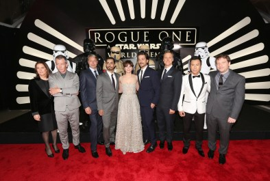 """HOLLYWOOD, CA - DECEMBER 10: (EDITORS NOTE: Image has been shot in black and white. Color version not available.) (L-R) Producer Kathleen Kennedy, actors Ben Mendelsohn, Mads Mikkelsen, Riz Ahmed, Felicity Jones, Diego Luna, Alan Tudyk, and Donnie Yen, and director Gareth Edwards attend The World Premiere of Lucasfilm's highly anticipated, first-ever, standalone Star Wars adventure, """"Rogue One: A Star Wars Story"""" at the Pantages Theatre on December 10, 2016 in Hollywood, California. (Photo by Jesse Grant/Getty Images for Disney) *** Local Caption *** Ben Mendelsohn; Riz Ahmed; Felicity Jones; Diego Luna; Donnie Yen; Mads Mikkelsen; Alan Tudyk; Gareth Edwards; Kathleen Kennedy"""