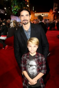 """HOLLYWOOD, CA - DECEMBER 10: Singer Kevin Richardson of Backstreet Boys (top) and Maxwell Richardson attend The World Premiere of Lucasfilm's highly anticipated, first-ever, standalone Star Wars adventure, """"Rogue One: A Star Wars Story"""" at the Pantages Theatre on December 10, 2016 in Hollywood, California. (Photo by Jesse Grant/Getty Images for Disney) *** Local Caption *** Kevin Richardson; Maxwell Richardson"""