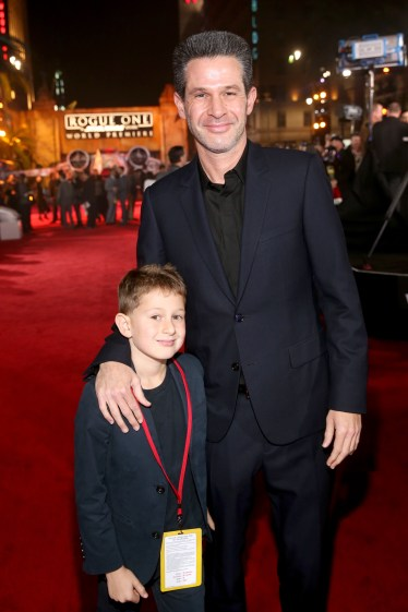 "HOLLYWOOD, CA - DECEMBER 10: Producer Simon Kinberg (R) and guest attend The World Premiere of Lucasfilm's highly anticipated, first-ever, standalone Star Wars adventure, ""Rogue One: A Star Wars Story"" at the Pantages Theatre on December 10, 2016 in Hollywood, California. (Photo by Jesse Grant/Getty Images for Disney) *** Local Caption *** Simon Kinberg"