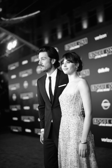 """HOLLYWOOD, CA - DECEMBER 10: (EDITORS NOTE: Image has been shot in black and white. Color version not available.) Actors Diego Luna (L) and Felicity Jones attend The World Premiere of Lucasfilm's highly anticipated, first-ever, standalone Star Wars adventure, """"Rogue One: A Star Wars Story"""" at the Pantages Theatre on December 10, 2016 in Hollywood, California. (Photo by Charley Gallay/Getty Images for Disney) *** Local Caption *** Diego Luna; Felicity Jones"""