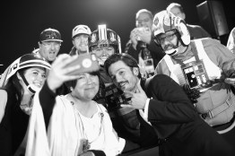 """HOLLYWOOD, CA - DECEMBER 10: (EDITORS NOTE: Image has been shot in black and white. Color version not available.) Actor Diego Luna takes a selfie with costumed fans at The World Premiere of Lucasfilm's highly anticipated, first-ever, standalone Star Wars adventure, """"Rogue One: A Star Wars Story"""" at the Pantages Theatre on December 10, 2016 in Hollywood, California. (Photo by Charley Gallay/Getty Images for Disney) *** Local Caption *** Diego Luna"""