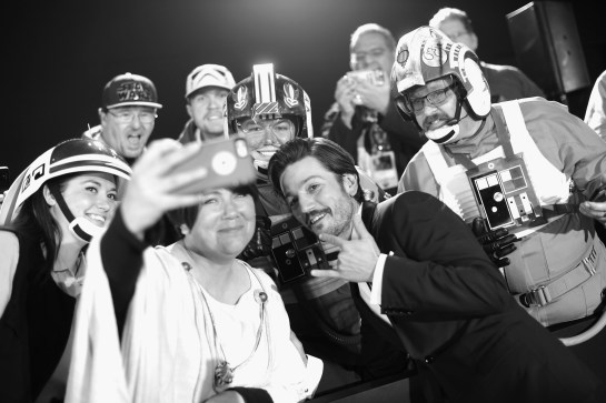 "HOLLYWOOD, CA - DECEMBER 10: (EDITORS NOTE: Image has been shot in black and white. Color version not available.) Actor Diego Luna takes a selfie with costumed fans at The World Premiere of Lucasfilm's highly anticipated, first-ever, standalone Star Wars adventure, ""Rogue One: A Star Wars Story"" at the Pantages Theatre on December 10, 2016 in Hollywood, California. (Photo by Charley Gallay/Getty Images for Disney) *** Local Caption *** Diego Luna"