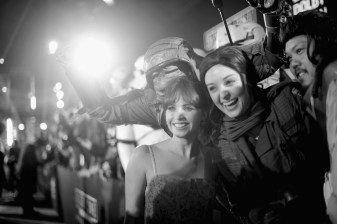 "HOLLYWOOD, CA - DECEMBER 10: (EDITORS NOTE: Image has been shot in black and white. Color version not available.) Actress Felicity Jones poses with a fan at The World Premiere of Lucasfilm's highly anticipated, first-ever, standalone Star Wars adventure, ""Rogue One: A Star Wars Story"" at the Pantages Theatre on December 10, 2016 in Hollywood, California. (Photo by Charley Gallay/Getty Images for Disney) *** Local Caption *** Felicity Jones"